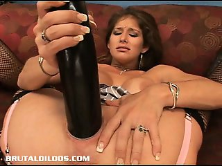 Busty babe Felony fills her pussy with a monster dildo