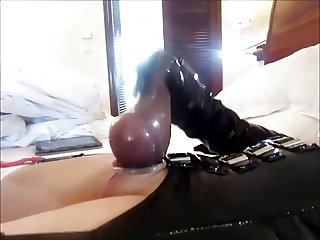 condom streched over balls and cum in