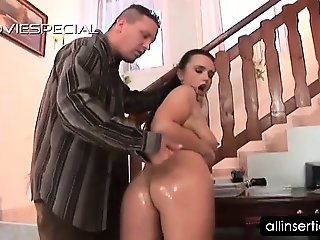 Curvy brunette gets body massaged with oil