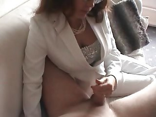 Nasty milf gives a handjob