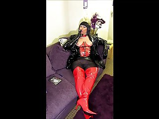 Chrissie smoking in red thighboots