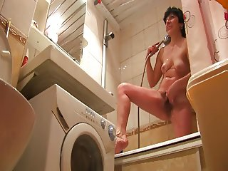 Mature wife takes a shower