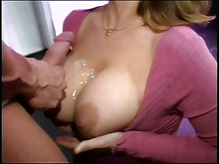 Big tits chick with glasses sucking cock
