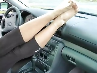 Beautiful feet in a car
