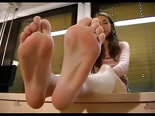 Teen Shows Off Feet In Class