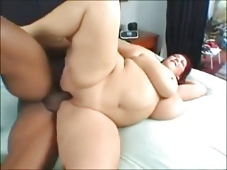 A BEAUTIFUL BIG WOMAN ENJOYS A BIG BLACK COCK