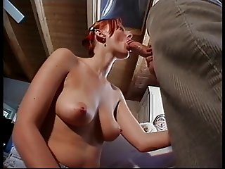 Redhead Kelly Sparks sucking Joel Lawrence's cock