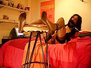 Tranny waits for stocking foot punishment