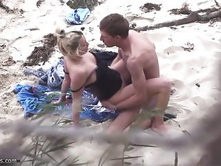 Couple fucking on the beach