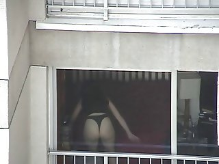 Real Voyeur - Spying Neighbor out the Window in Tanga