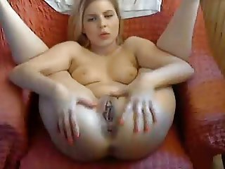 Young slut spreads and fingers pussy with legs up