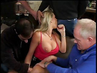 Beautiful breasty blond stabbed by four cocks on a couch