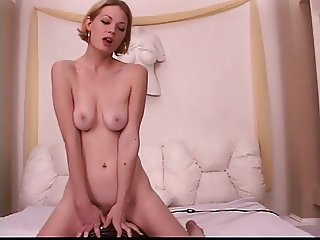 Blonde is getting nasty in the shower while fingering pussy