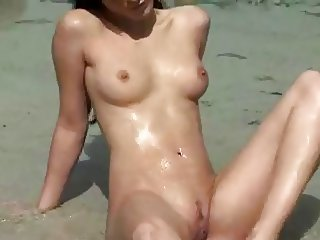Nude Beach - Hot Brunette Posing on the Shore