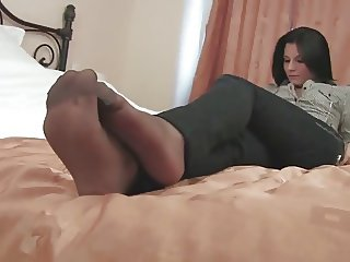 Black pantyhose girl playing smart phone