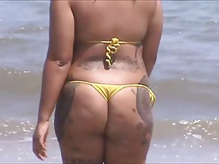 candid spanish milf ass in micro bikini at beach 46