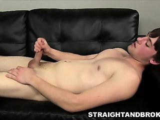Straight hunk tugging his cock on the couch for cash