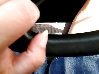 Playing with my shaved pussy while driving