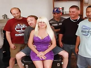 Delicious blonde girl with big tits gangbang
