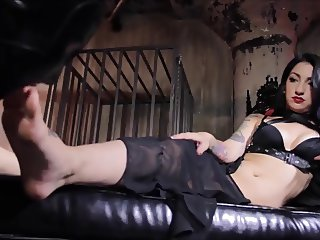 beautiful mistress use foot slave