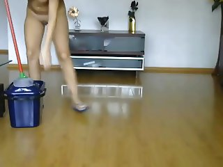 Nude girl cleaning the home 1
