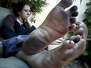 Older woman showing her dirty feet
