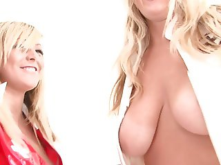 Hot blondes with natural tits do some naked wrestling in bed