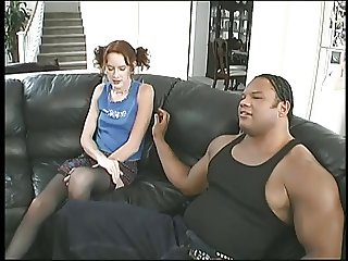 Young redhead schoolgirl takes black cock and facial on a couch