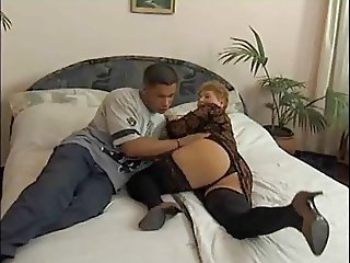 Granny and boy on bed