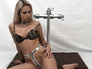 Woman with chastity belt and metal collar