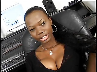 Ebony chicks fucking with a strap on at the studio