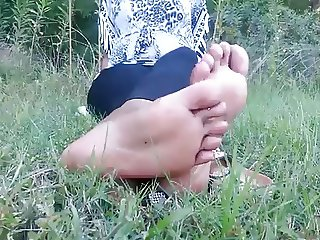 Big Black Boong Feet of an Australoid Abo Woman in the Grass