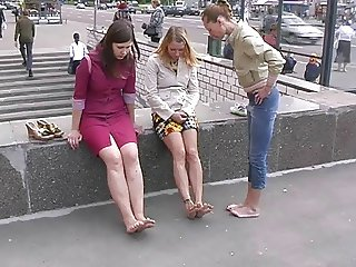 3 girls walking barefoot in the street