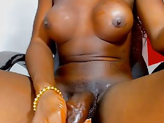 Black latin shemale with huge cock & big balls jerking off