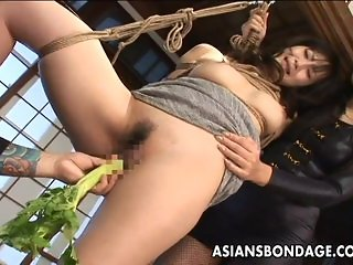 Tied up Asian babe gets spanked and dildo fuc