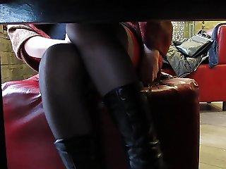 Black stockings with red tops undert the table