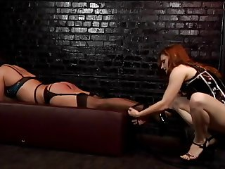 Redhead dominatrix ties guy up and gives him a whipping