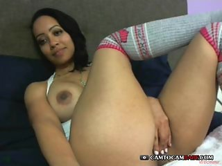 Fake tits Latina girl fingers cunt on cam