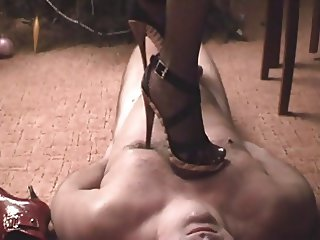 slave cums under extreme high heel nipple torture