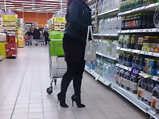 wife went shopping in fashionable high heels knee high boots