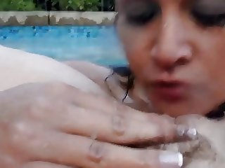 Lesbian pussy licking in pool