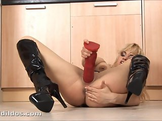 Blonde babe swallows a huge dildo and squirts