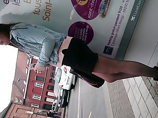Candid in pantyhose at stop bus