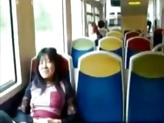 Asian milf rubs her clit on a train.