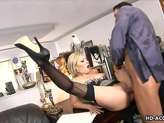 Lingerie wearing blonde ball sucker is fucked