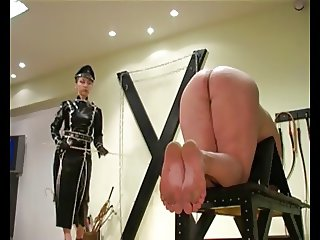 Brutal Femdon Goddess dressed in black latex tortures..