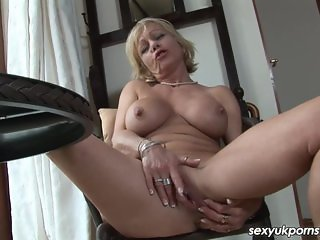 Mature British blonde dildos her pierced cunt