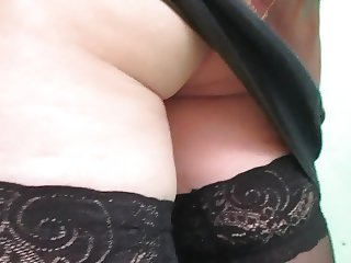 Lift up her skirt to see stockings tops