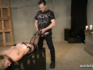 Tied blonde slave gives Master a footjob