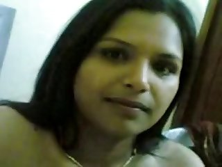 Cute Bangalore housewife with big tits poses naked on cam